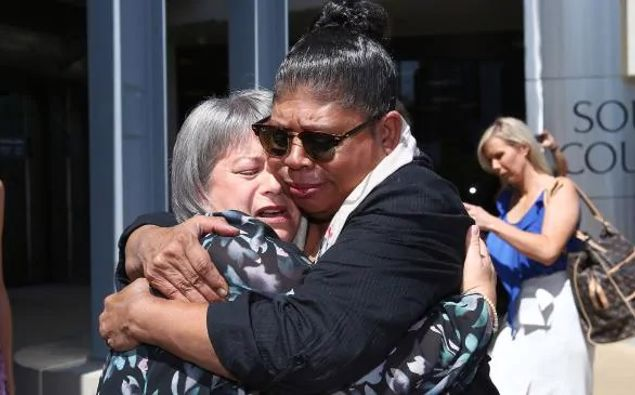 Donna Baluskas breaks down after meeting Kathleen Toplis outside court, Kathleen told Donna her son took his own life after attending Tamborine Mountain State High School. Picture: Adam HeadSource:News Corp Australia