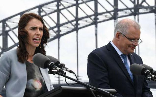 New Zealand Prime Minister Jacinda Ardern challenging Scott Morrison over Australia's deportation policies. (Photo / Getty)