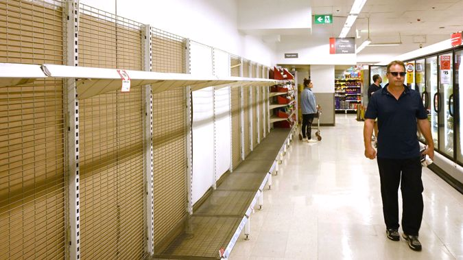 Shelves are empty of toilet rolls in a supermarket in Sydney. (Photo / AFP)