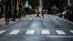 Pedestrians pass an empty Gran Via street, in Bilbao, northern Spain. Photo / AP