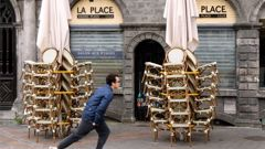 A young man rides a scooter in Lille, northern France. Photo / AP