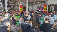 Shoppers queue at a PaknSave.