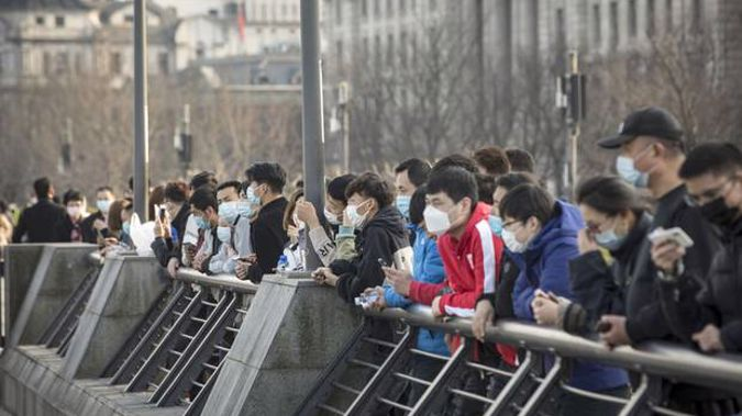 People wearing protective masks in Shanghai, China. Photograph / AP