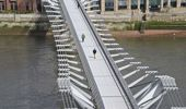 Pedestrians cross a quiet Millennium Footbridge across the River Thames in London. (Photo / Getty)