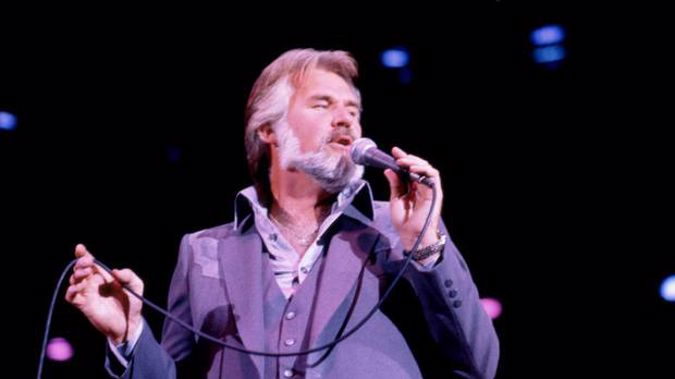 Kenny Rogers sings on stage in 1981. Photo / Getty Images