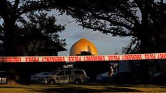A police officer stands guard in front of the Masjid Al Noor mosque in Christchurch following the attacks. Photo / AP
