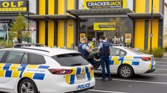 Police officers enforcing the Covid-19 lockdown paid a visit to a Crackerjack store in Hamilton this morning. Photo / Mike Scott