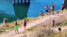 Covid 19 coronavirus: Group spotted jumping off bridge into river during lockdown