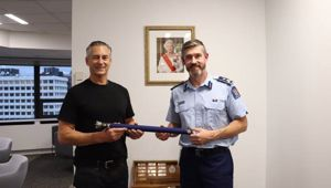 Changing of the guard: Mike Bush passes the top cop baton over to new Commissioner Andrew Coster last night. Photo / NZ Police
