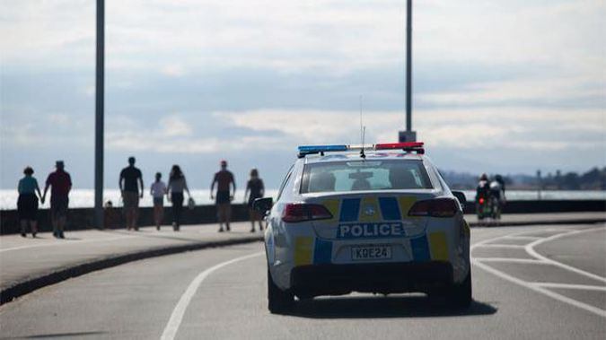 Police patrol Auckland's Tamaki Drive on day 10 of the lockdown. Photo / Sylvie Whinray