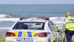 Police in Gisborne go to speak to surfers breaking lockdown rules. Photo / Gisborne Herald