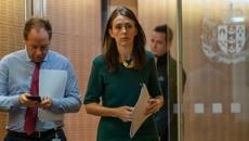 Jacinda Ardern defends delay in quarantining all international arrivals