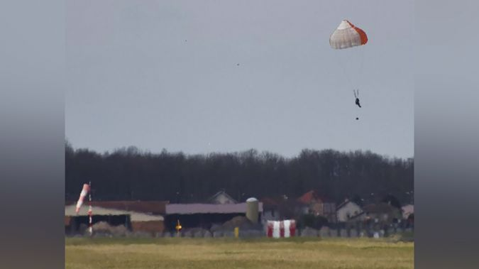 The 64-year-old passenger landed in a field near the German border.