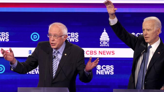 Bernie Sanders with Joe Biden in a debate. (Photo / AP)