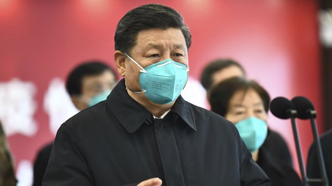 Chinese President Xi Jinping talks by video with patients and medical workers at the Huoshenshan Hospital in Wuhan in central China's Hubei Province. (Photo / via AP)