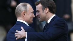 French President Emmanuel Macron, right, hopes Russian President Vladimir Putin will back his call. (Photo / AP)