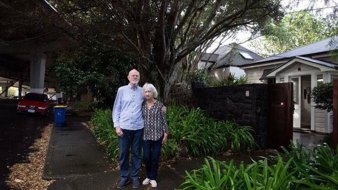 Northcote residents Carol and Rod Brown are fighting plans to remove their house (right) to make way for the new Skypath on the Auckland Harbour Bridge. (Photo / Sylvie Whinray)