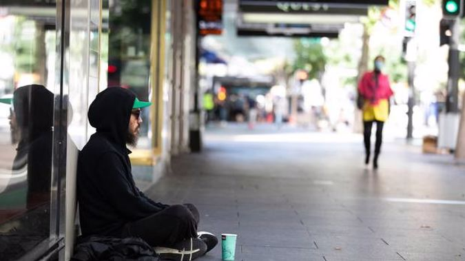 A homeless person on Queen St, Auckland, before the Covid-19 level 4 lockdown was enforced. Photo / Brett Phibbs