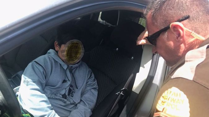 A five-year-old boy was pulled over by the Utah Highway Patrol while driving his family's vehicle by himself. (Photo / Utah Highway Patrol)