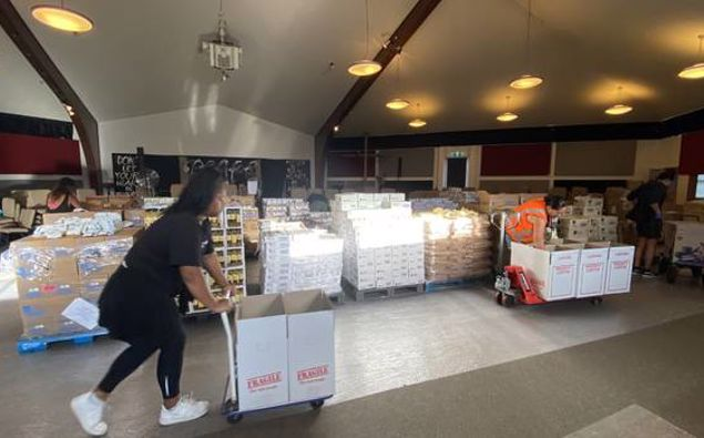Staff at social service organisation VisionWest prepare goods to deliver to those in need in West Auckland. Photo / Supplied