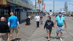 People traverse the Seaside Heights boardwalk in New Jersey as the state begins to reopen beaches and boardwalks. (Photo / Getty0