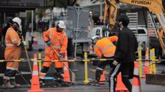 Part of Auckland's Queen Street has been closed due to a burst water main. (Photo / Michael Craig)