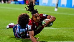 Leicester Faingaanuku of the Crusaders scores a try in the tackle of Henry Speight of the Reds. (Photo / Photosport)
