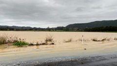 Flooding on SH25 between Tairua and Whitianga after heavy rainfall overnight. (Photo / Georgie Hood)