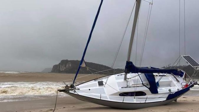 Yacht beached at Flaxmill Bay. Photo / Penny Yates, Cooks Beach Community Facebook group.