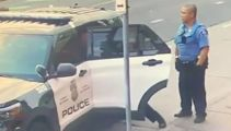 Video shows George Floyd in struggle in back of police car before death
