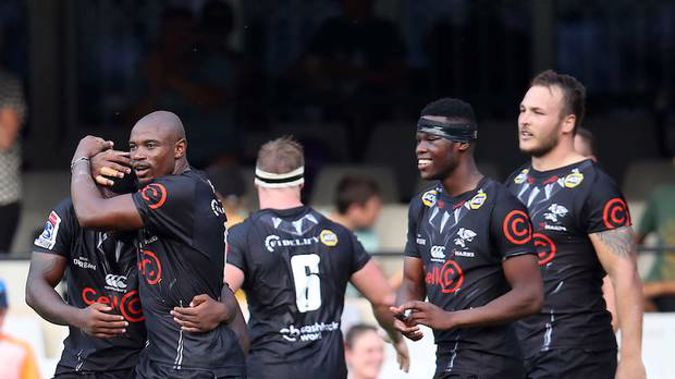 Makazole Mapimpi of the Sharks celebrates a try with teammates. (Photo / Supplied)