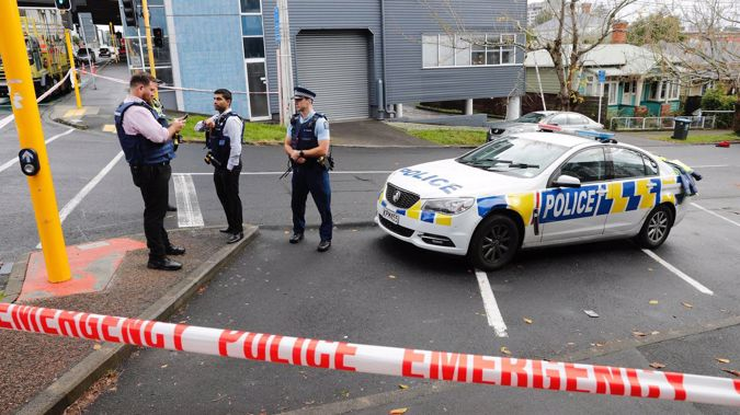 Police on the scene in Grafton, Auckland, this morning. (Photo / Dean Purcell.)