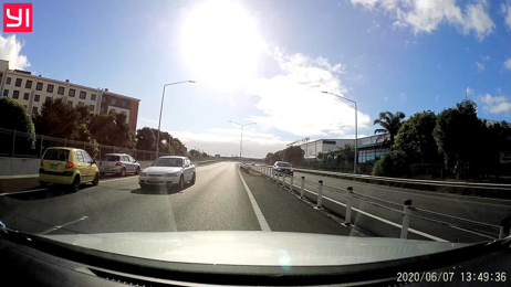 Watch: Dashcam catches dangerous driver on wrong side of road in Auckland