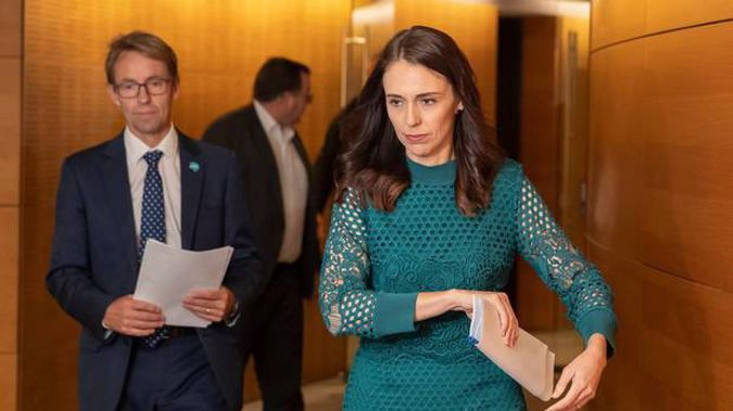 Jacinda Ardern did a little dance at the news the country was Covid free, while Ashley Bloomfield resisted and opted for a smile instead. Photo / Mark Mitchell