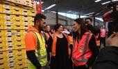 Prime Minister Jacinda Ardern chats with staff at Trevelyan's kiwifruit packhouse in Te Puke. Photo / George Novak