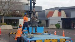 The statue of Captain John Fane Charles Hamilton being removed.