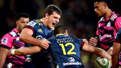 Dillon Hunt of the Highlanders celebrates with Patelesio Tomkinson after his try. Photo / Photosport