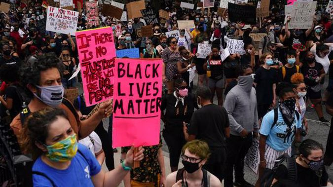 People gather outside the Georgia State Capitol during a protest against police brutality in Atlanta. Photo / Getty Images