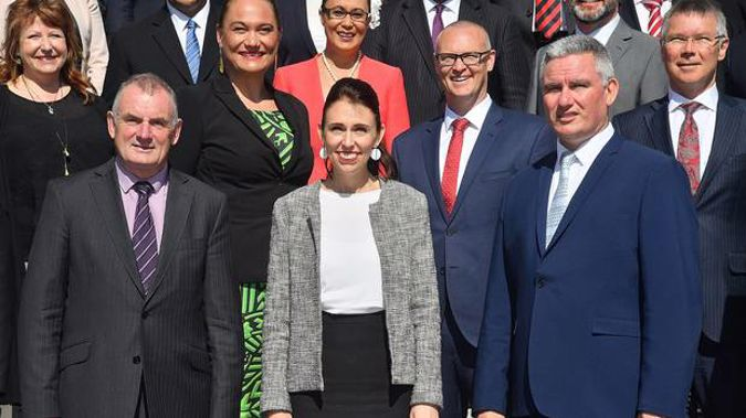 Prime Minister of New Zealand Jacinda Ardern with MP's Trevor Mallard and Kelvin Davis in front of Parliament. Photo / Marty Melville