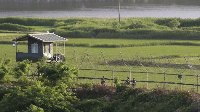 South Korean army soldiers patrol along the barbed-wire fence in Paju, near the border with North Korea. (Photo / AP)