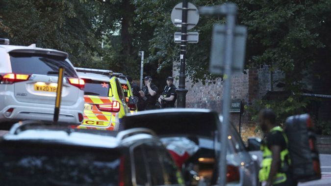 Police work at Forbury Gardens in the town centre of Reading, England. (Photo / AP)
