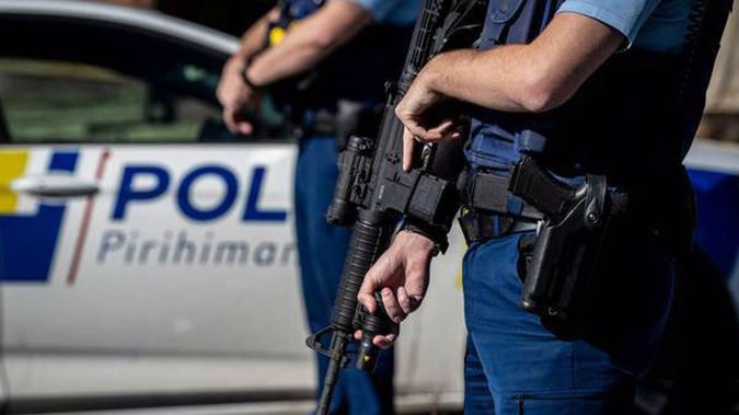 Armed police at the scene of the shooting in Massey. (Photo / NZ Herald)