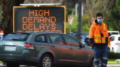 Traffic management is seen outside a COVID-19 testing facility at Northland shopping centre in Melbourne. (Photo / AAP)