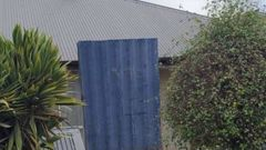 A Christchurch social housing tenant claims her neighbours built this shield after two shootings at the property.