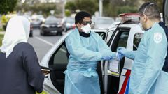 Paramedics perform Covid-19 tests in Broadmeadows after Victoria State Government Health and Human Services people knock on doors to check if people have any symptoms of and would like a test. (Photo / AAP)