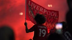 Liverpool supporters celebrate as they gather outside of Anfield Stadium. (Photo / AP)