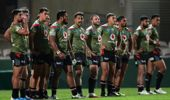 Warriors players look dejected after another Storm try. Photo / Getty