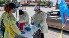 Medical staff from myCovidMD provide free COVID-19 virus antibody testing in Inglewood, California. (Photo / Getty)