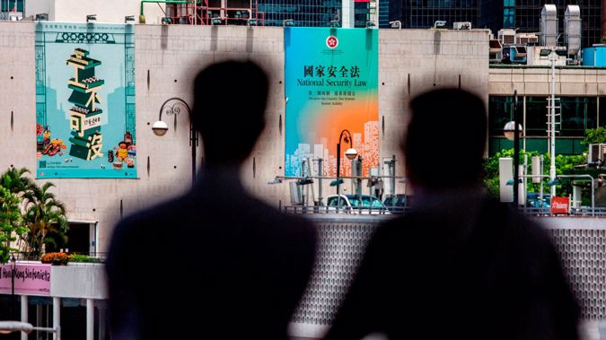 A government advertisement (center) promoting Chinas planned national security law is displayed on the city hall building in Hong Kong. (Photo / Getty)