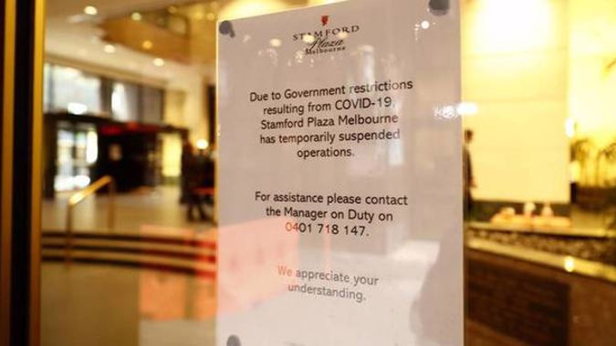 Signage outside the Stamford Plaza announcing the suspension of operations. Photo / Getty Images